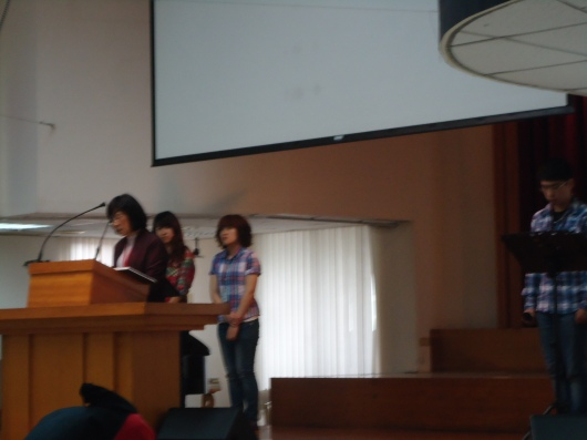 Pastor with worship team