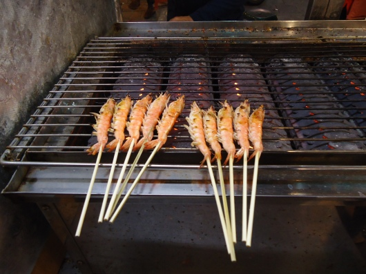"10 grilled ""lazy"" shrimps for 60 NT, about US$2, so-called because you're too lazy to peel & eat them with head & shell."