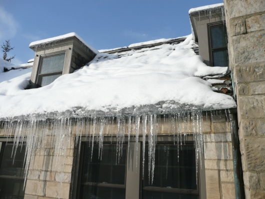 Icicles along eaves trough spell trouble.