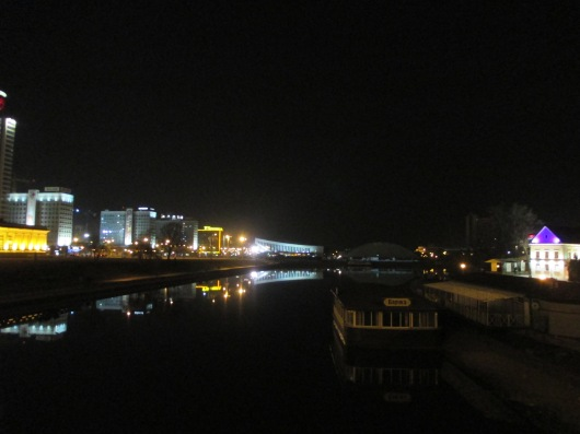Night view of river running through the city.