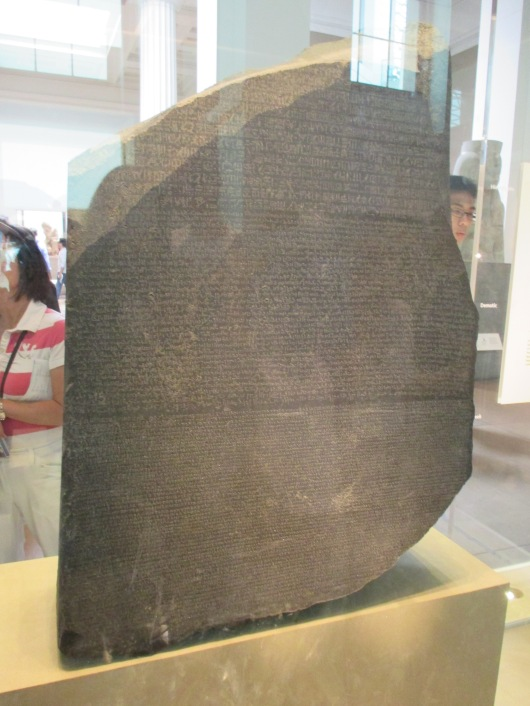 Rosetta Stone, written in Hieroglyphic, Demotic (Egyptian), and Ancient Greek. It helped to decode ancient languages.