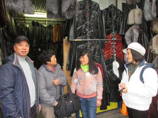 Talking to merchants in the market.