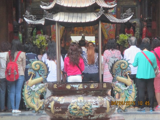 Tourists come by busloads to pay homage to the black-faced Mazu