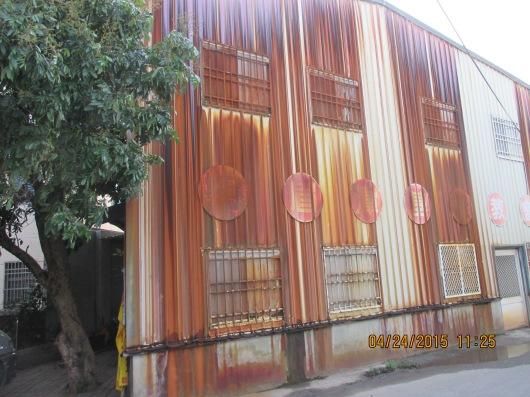 Corrugated steel building