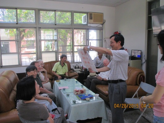Enjoying tea and calligraphy in principal's office